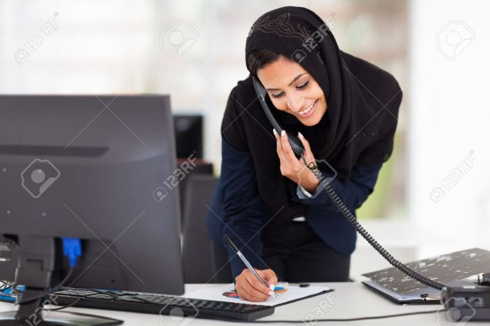 18500717-happy-young-middle-eastern-businesswoman-working-in-office-Stock-Photo