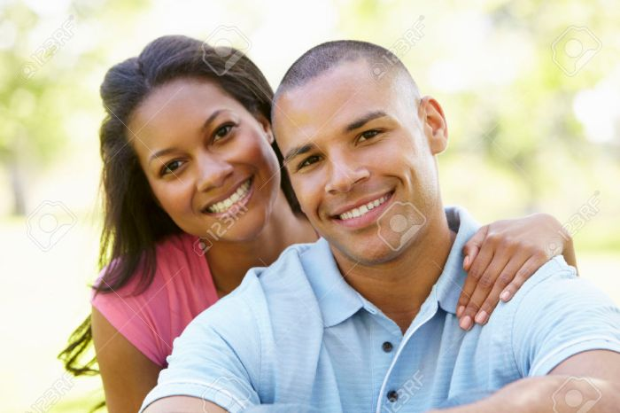 42109747-Portrait-Of-Romantic-Young-African-American-Couple-In-Park-Stock-Photo.jpg