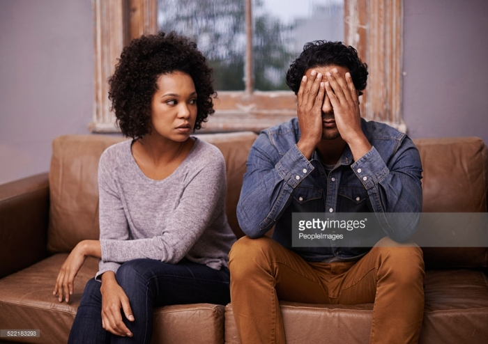 A young ethnic couple having relationship problems