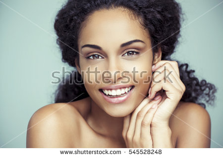 stock-photo-portrait-of-a-beautiful-young-african-woman-smiling-545528248.jpg